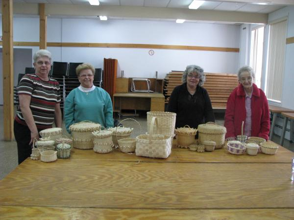 Women with thier final product of baskets