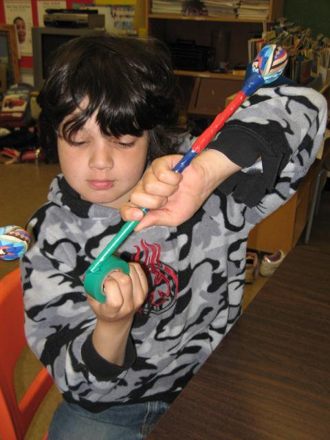 A kid making drum stick for the drum