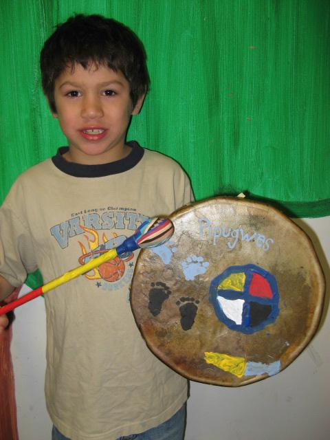 Kid showing his finished drum