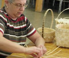 Woman making a basket
