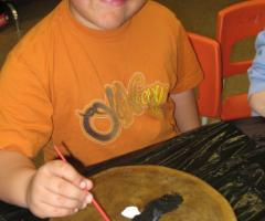 Kid painting his drum