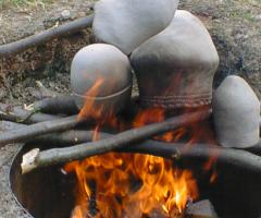 Putting pottery on the fire