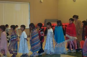 The children are dancing and as you can see most of them have either full regalia or a shawl.