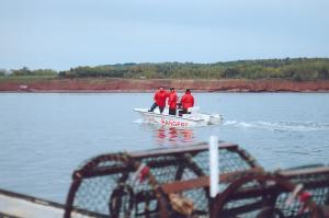 The men in red are the Listuguj Rangers who monitor the Restigouche River.