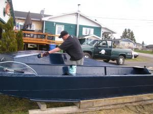Preparing for salmon season may include painting your boat.