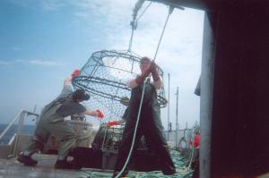 These fishermen are unstacking each trap one by one and preparing them for launch.