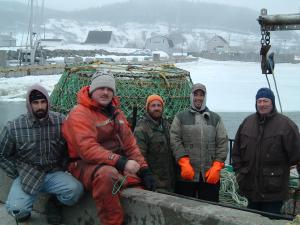 These fishermen are prepared for the cold weather of the early spring crab fishing season.