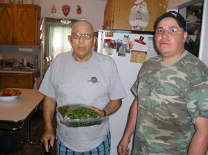 An elder appreciating the gift of fiddleheads from a young man.