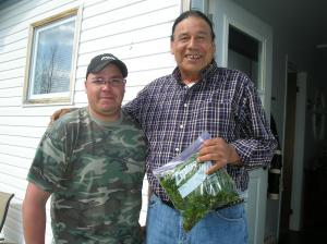 This man is proud of the younger man who just gave him a feed of fiddleheads, it's well appreciated.