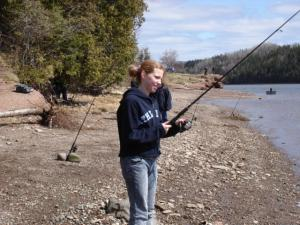 Young girls too take time to go fishing. It's a fun and calming activity for everyone.