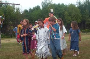 The children have watched their families gather and dance in regalia and now they are continuing the tradition.