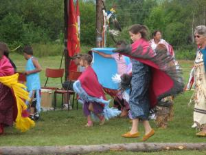 The children love to dance all day with their shawls flowing in the air and with their moccasins tapping the ground.