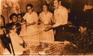 Back in the day, families all gethered together to prepare the nets for the upcoming salmon season.