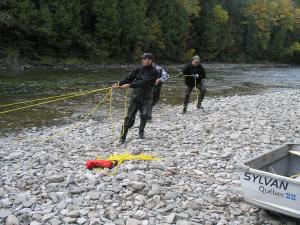 After you set your salmon net across the river, you have to stretch it out and make sure it is nice and tight.