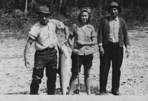 The Mi'gmaq people are excellent guides on the waters. As seen here they guided this American woman to catch a salmon.