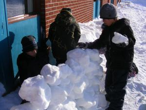 The snow brings warmth and shelter to the earth and animals but in this picture it brings fun for the children. The children are