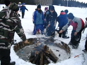 Winter fires are very common in the colder months, they are used to keep warm, but here the children are using it for roasting t
