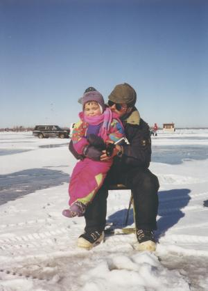 This little girl is learning about ice fishing.