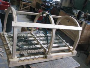 This is a lobster trap that is being built for the fishing season.