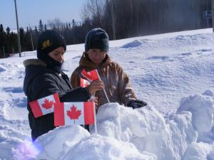 The children are marking their igloo with Canadian flags, the Mi'gmaq have their own flag that signifies there Nation.
