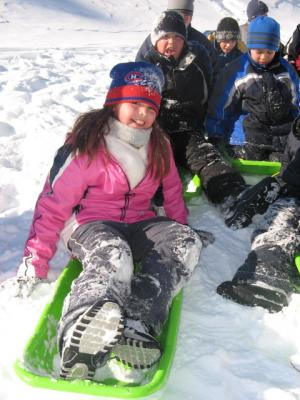 Sliding with your friends is a fun way to pass the winter.