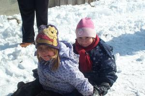 The children enjoy winter time sliding.