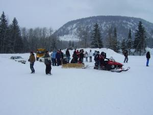 Skidoos are great for hauling children on sleds, but it is important to do so in a safely manner.